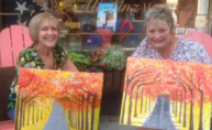 Robin and Carolynn with their autumn paintings
