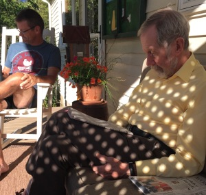 Bill and Peter relax in polka-dotted sunshine.