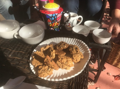 A proper tea with tea pot and fresh baked cookies.